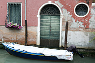 Italy, Venice, Boat in front of house - AWDF00043