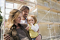 Young family in front of New Home Under Construction - WESTF09135