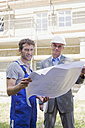 Architect and Construction worker holding construction plan - WESTF09124
