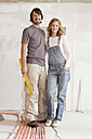 Young couple in an unfinished building, portrait - WESTF09022