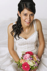Young bride holding flowers, elevated view - NHF00877