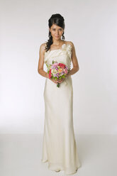 Young bride holding bouquet - NHF00855