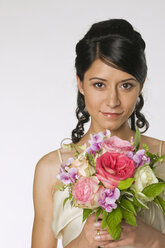 Young bride holding flowers, close-up - NHF00845