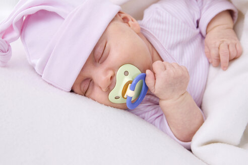 Baby girl (2 months) sleeping with pacifier, portrait - SMO00283