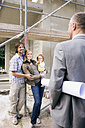 Architect and young family at construction site - WESTF09151