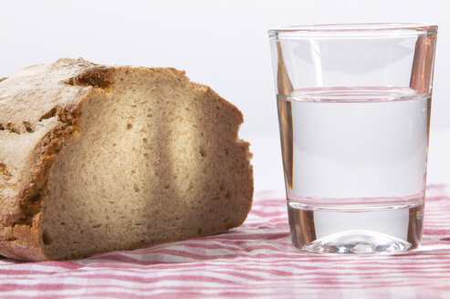Bread and a glass of water, close-up - THF00904