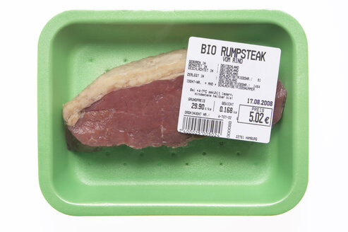 Raw steak in styrofoam box, elevated view - THF00886