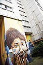 Germany, Berlin, Town building, house front decorated with painting graffiti, close-up - 00355DH-U