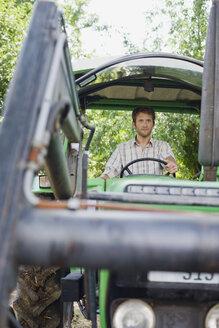 Farmer sitting in tractor - BMF00430