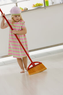 Little girl (4-5) playing with broom - SMO00343