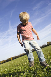 Little boy (4-5 years) playing in the meadow - SMO00268