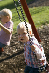Two little boys ( 2-3) (4-5) sitting on swing - SMO00247