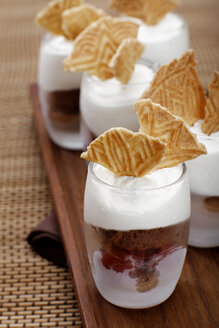 Chocolate ice cream with cherries, whipped chream and ice wafer - SCF00333