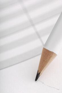 Pencil and paper, close-up - 00454LR-U
