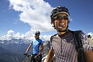 Germany, Bavaria, Karwendel, Couple with mountain bikes, smiling - MRF01101
