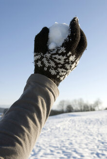 Human hand holding snowball, close-up - AWDF00279