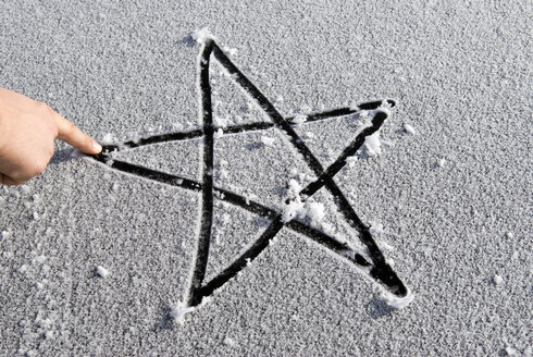 A Star drawn into snow by an index finger, elevated view - AWDF00267