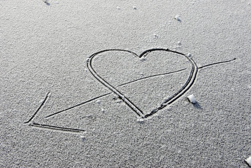 A Heart with arrow drawn into snow, elevated view - AWDF00264