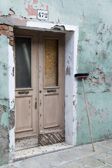 Italy, Venice, Old house, Broom leaning against wall - AWDF00203