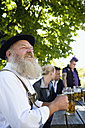 Germany, Bavaria, Upper Bavaria, Man in traditional costume holding beer stein, portrait - WESTF09730