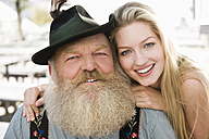 Germany, Bavaria, Upper Bavaria, Senior man and young woman, smiling, portrait, close-up - WESTF09612