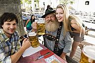 Germany, Bavaria, Upper Bavaria, People in beer garden - WESTF09609