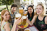 Germany, Bavaria, Upper Bavaria, Young people in beer garden, smiling - WESTF09600