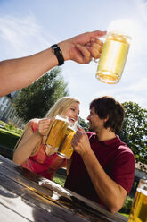 Germany, Bavaria, Upper Bavaria, Young couple in beer garden - WESTF09594