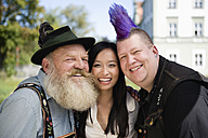Germany, Bavaria, Upper Bavaria, Three people having fun, smiling, portrait - WESTF09549