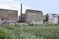 Germany, Berlin, Old factory building with graffiti - PMF00629
