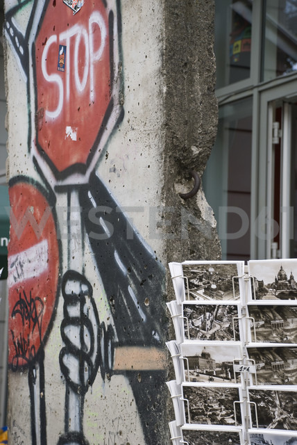 Germany, Berlin, House wall, graffiti and post cards - PM00767