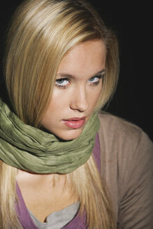 Young woman wearing scarf, portrait, close-up - OW00865