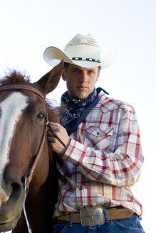 USA, Texas, Dallas, Cowboy with horse, portrait - PK00258
