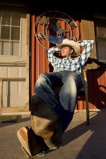 USA, Texas, Dallas, Cowboy sitting on Veranda - PK00252
