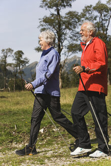 Austria, Karwendel, Ahornboden, Senior couple nordic walking - WESTF10552