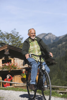 Austria, Karwendel, Senior man biking - WESTF10510