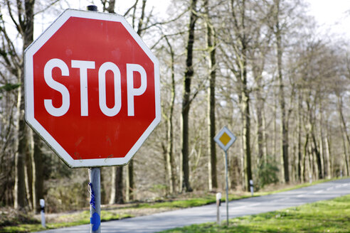 Stop sign on road, close-up - KSWF00222
