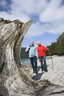 Germany, Bavaria, Walchensee, Senior couple hiking on lakeshore - WESTF10188