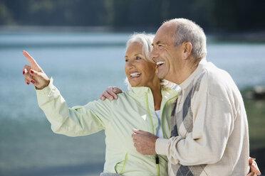 Germany, Bavaria, Walchensee, Senior couple, laughing - WESTF10118
