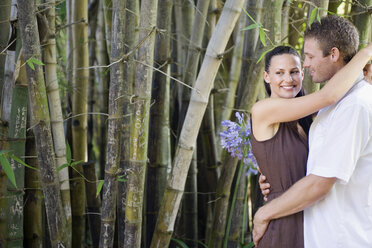 Young couple embracing smiling, portrait - ABF00488