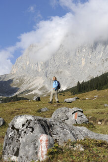 Germany, Bavaria, Wetterstein, Young woman hiking in mountains - MRF01133