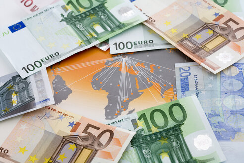 Variety of Euro notes on map, close up - MAEF01332