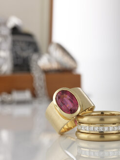 Two rings in foreground, in the background jewel box - AKF00054