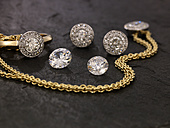 Jewellery on black sand - AKF00024