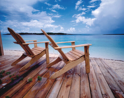 Bahamas, Deck chairs on beach - RRF00180
