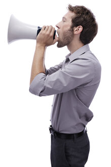 Young man holding megaphone, side view, portrait - BMF00509