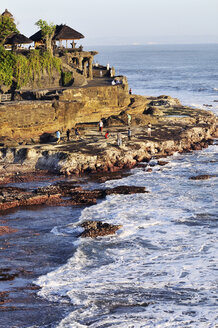 Indonesia, Bali, Tanah Lot Temple on offshore rock with tourists - MB00908