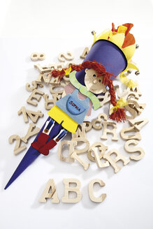 Colourful school cone and capital letters, elevated view - 10814CS-U