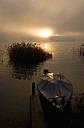 Austria, Salzkammergut, Lake Irrsee, boat at anchor, break of dawn - WW00806