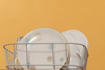 Plates, glass and mug in rack - KJF00034